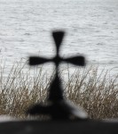 Photo of a cross by the sea