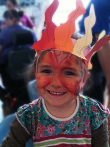 Pentecost Celebration, a child with painted face and wearing a crown