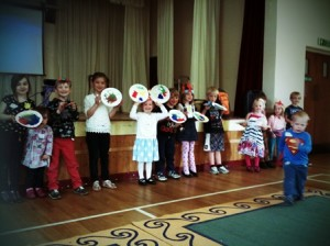 A group of children showing completed activities at Messy Church