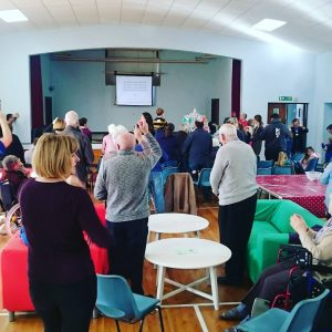 People worshiping at messy church